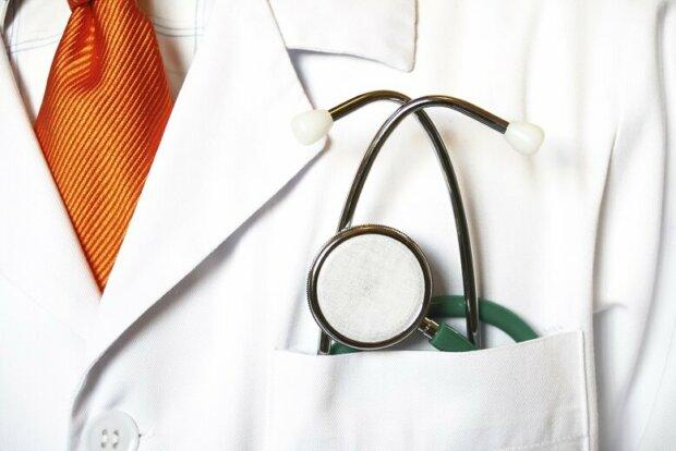 Arztkittel mit Krawatte